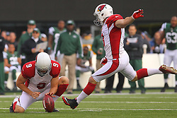 Dec 2, 2012; East Rutherford, NJ, USA; Arizona Cardinals kicker Jay Feely (3) kicks a field goal during the first half of their game against the New York Jets at MetLIfe Stadium.