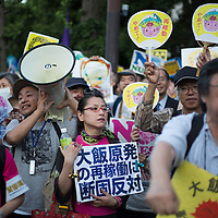 Protesters gather on the streets opposite Prime Minister Noda's official residence, to protest against Japan's nuclear energy policies and the restarting of nuclear reactors which are currently offline undergoing safety checks, in Tokyo, Japan, on Friday 29 June 2012.