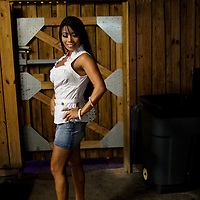 A dancer poses for a portrait on the back patio of the world famous Mons Venus strip club in Tampa, Florida.