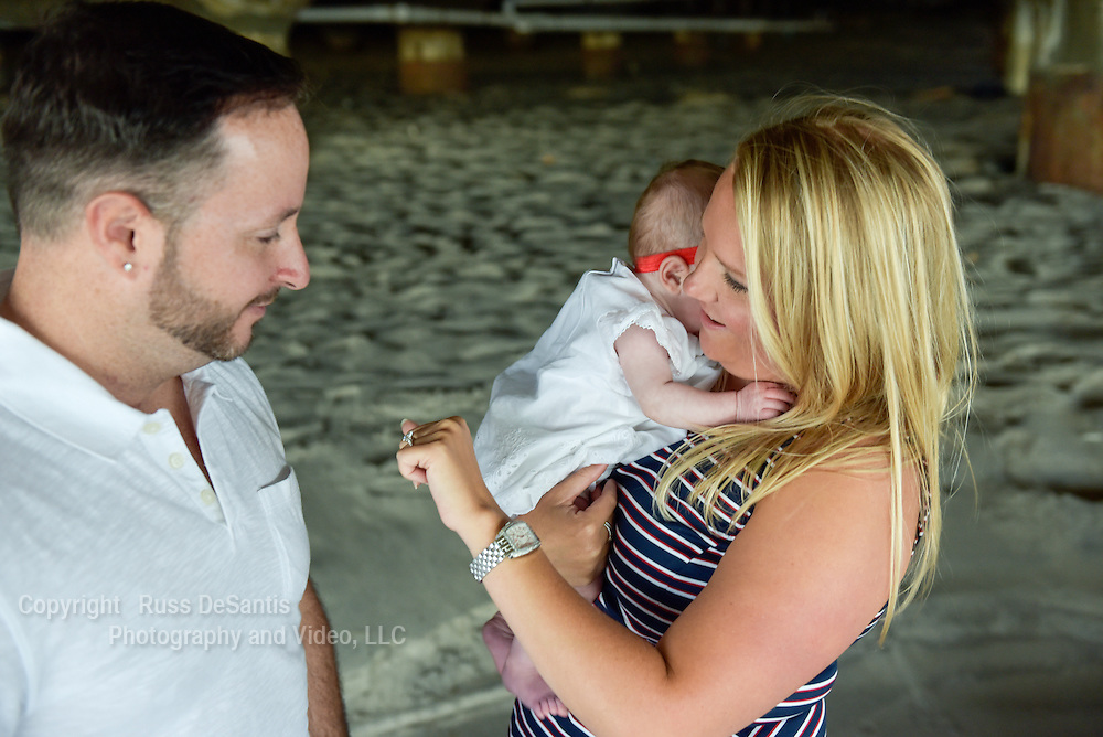 Allan Nunes-Vais proposed to Danielle at the beach in Asbury Park, NJ, on Monday, September, 26, 2016. Baby Olivia was the witness. / Russ DeSantis Photography and Video, LLC