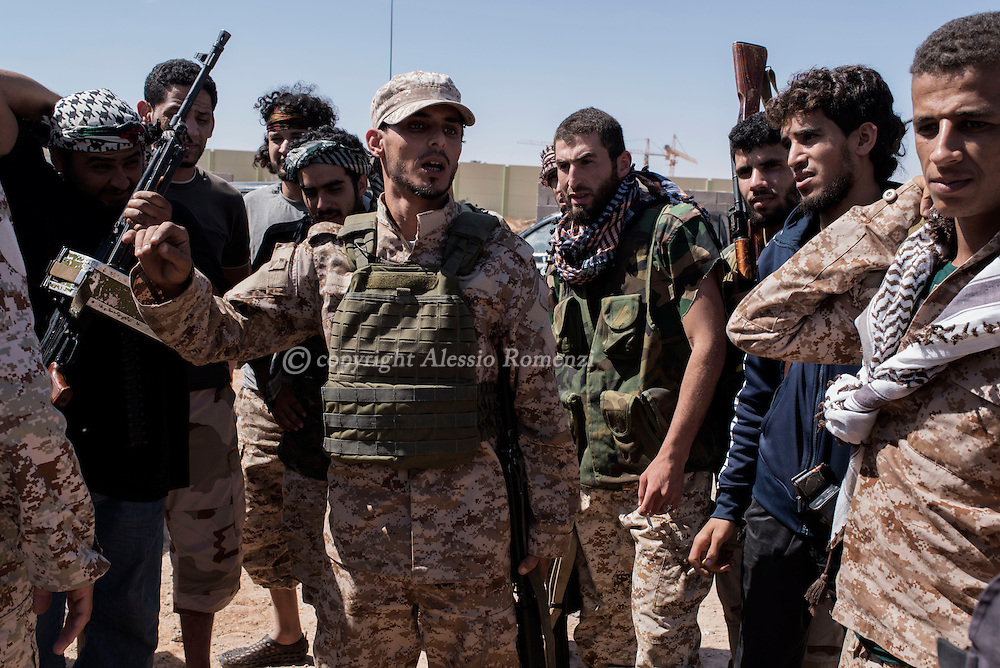 Libya: A Libya's Government of National Accord's (GNA) commander gives instructions to his fighters right before to enter 700 neighbourhood in Sirte still under ISIS control. Alessio Romenzi