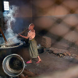 Residents of the Kabanga Protectorate Center and School in Tanzania prepare lunch.