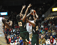 Ole Miss's Murphy Holloway (31) is tied up by Mississippi Valley State's Montrell Holley (42) and Blake Ralling (22) in Oxford, Miss. on Friday, November 9, 2012.