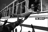 Conscripts are cheered off from the capital, Asmara, as they leave to begin their mandatory 2-year National Service. .Eritrea emerged from a 30-year struggle for Independence only to slip back in to a bloody border war with its old adversary, Ethiopia. An estimated 100,000 soldiers from both sides died in the conflict..