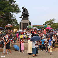 (092015  Havana, Cuba) Cuban youth huddle under umbrellas an event with Pope Francis outside Father Felix Varela cultural center in Havana, Sunday,  September 20, 2015. photo by Angela Rowlings.