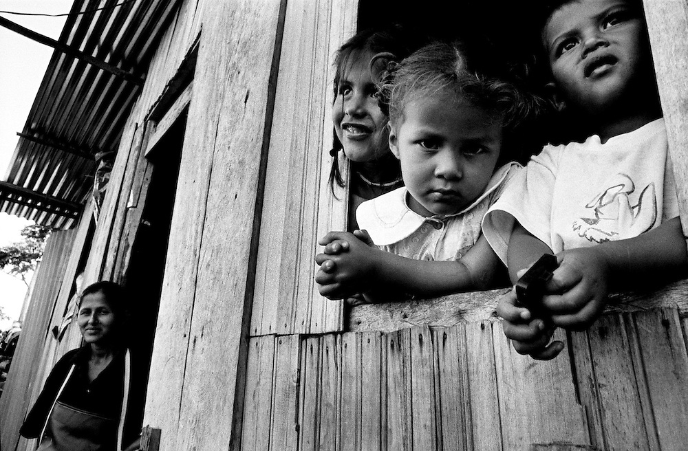 A mother and her children who were displaced from their homes by ongoing violence.<br />