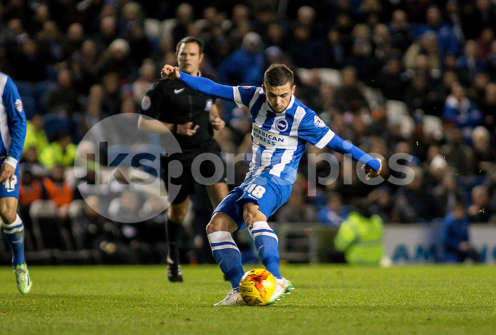 Jake Forster-Caskey of Brighton shoots during the Sky Bet Championship match between Brighton and Hove Albion and Millwall at the AMEX Stadium, Brighton, England on 12 December 2014. Photo by Liam McAvoy.