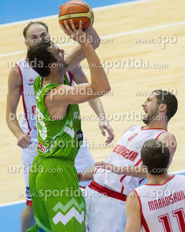 Mirza Begic of Slovenia vs George Tsintsadze #8 of Georgia during basketball match between National teams of Georgia and Slovenia in Round 1 at Day 4 of Eurobasket 2013 on September 7, 2013 in Arena Zlatorog, Celje, Slovenia. (Photo by Vid Ponikvar / Sportida.com)