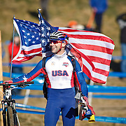 SHOT 1/12/14 3:07:47 PM - Cycling coach Neal Henderson of Boulder, Co. takes in some of his athletes while cheering them on at the 2014 USA Cycling Cyclo-Cross National Championships at Valmont Bike Park in Boulder, Co.  (Photo by Marc Piscotty / © 2013)