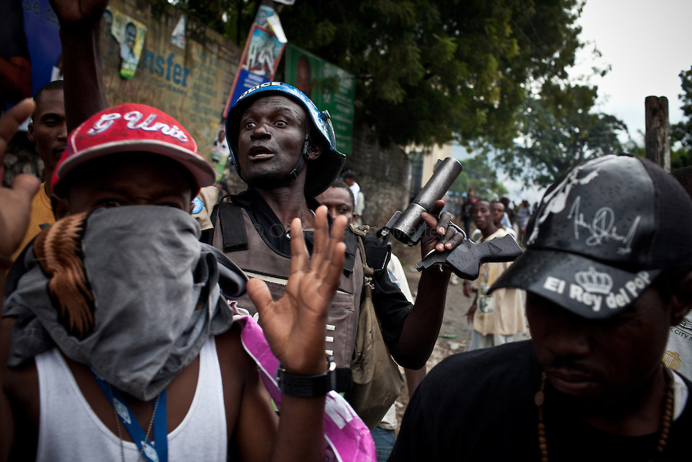 Martelly's supporters demonstrate, in the streets of Port-au-Prince in front of the UN Police, to protest against the results of the presidential elections and the defeat of their leader, Michel Martelly.