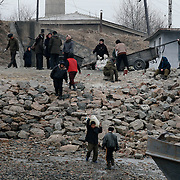 North Korean load a boat in the bank of the Yalu river in Sinuiju, North Korea, on Thursday, Feb. 8, 2007. The Six Party talks have started on the 8th of February in Beijing with the hope of terminating the nuclear program of North Korea