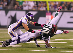 Oct 11, 2010; East Rutherford, NJ, USA; New York Jets running back LaDainian Tomlinson (21) is tackled by Minnesota Vikings linebacker Ben Leber (51) during the first half at the New Meadowlands Stadium.