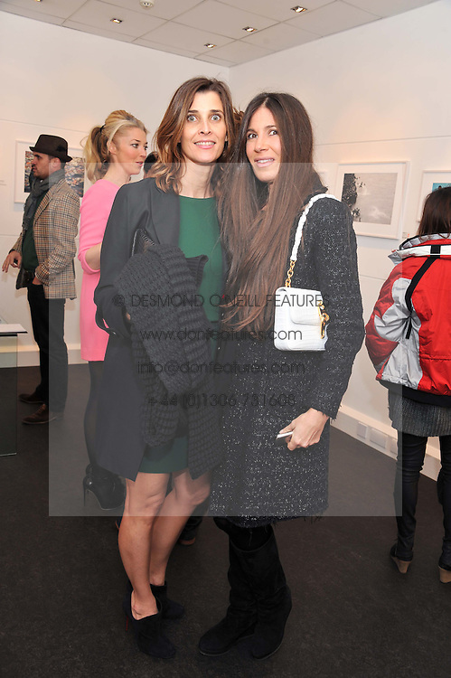 Left to right, PRINCESS ROSARIO SAXE-COBURG and ELIZABETH SALTZMAN at a private view of photographs by Anthony Souza held at The Little Black Gallery, 13A Park Walk, London SW10 on 13th December 2011.