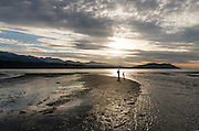 A father and his young son, from Arizona, explore the ever-shifting delta at the mouth of the Elwha River.