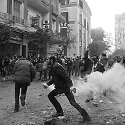 An Egyptian protestor hurls a tear gas canister back towards the police who shot it during ongoing demonstrations November 20, 2011 near Tahrir square in central Cairo, Egypt.  Protestors demanding the transition of power from military to civilian control clashed with Egyptian security forces for a second straight day in central Cairo, with hundreds injured and at least 11 protestors killed.  (Photo by Scott Nelson).