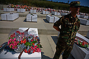 A Kosovo Protection Corp officer stands vigil next to the grave of KLA (Kosovo Liberation Army, aka UÇK) commander and Albanian-Kosovar national hero Adem Jashari in the town of Prekaz, where Jashari and dozens of family members and soldiers were killed by Serbian military forces in 1998..