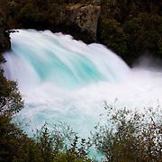 The Waikato River drops 11 meters (36 feet) at Huka Falls near Taupo, New Zealand. Huka Falls is the largest waterfall along the river.