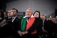 ROMA. UN DELEGATO AL PRIMO CONGRESSO NAZIONALE DEL PARTITO DEL POPOLO DELLA LIBERTA' CON IL TRICOLORE ITALIANO SULLE SPALLE
