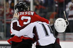 Feb 26, 2009; Newark, NJ, USA; New Jersey Devils right wing David Clarkson (23) knocks the helmet off Colorado Avalanche right wing Ian Laperriere (14) during their second period fight at the Prudential Center.
