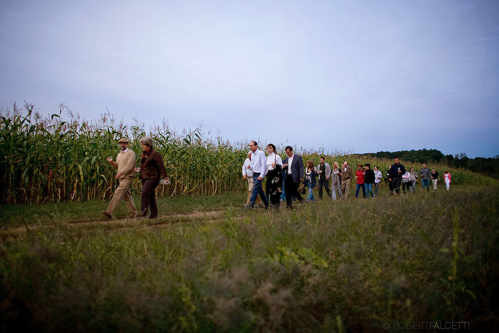 SOUTH GLASTONBURY, CONNECTICUT-10 September 2009-- Guests walk through a cornfield during a farm tour prior to the start of the Dinners at the Farm event held at Old Maids Farm in South Glastonbury, Connecticut. The dinner, hosted by farm owner George Purtill, was a benefit for Working Lands Alliance. (Photo by Robert Falcetti)