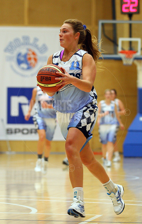 PERTH, AUSTRALIA - JULY 16: Jasmine Hooper of the Tigers drives to the basket during the week 18 SBL game between the Perry Lakes Hawks and the Willetton TIgers at The State Basketball Center on July 16, 2011 in Perth, Australia.  (Photo by Paul Kane/All Sports Photography)