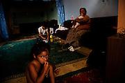 Family at home inside a UNHCR IDP camp for roma in north Mitrovica, Kosovo.