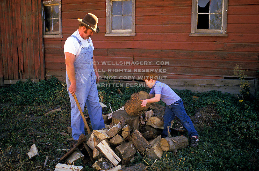 Image of Dick Ferguson and son Reed chop wood in the Palouse, Waitsburg, eastern Washington, Pacific Northwest, model and property released