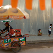 A street vendor in Siem Reap, Cambodia waits for customers. Tourists flock to Siem Reap to visit the ruins at Angkor Wat.