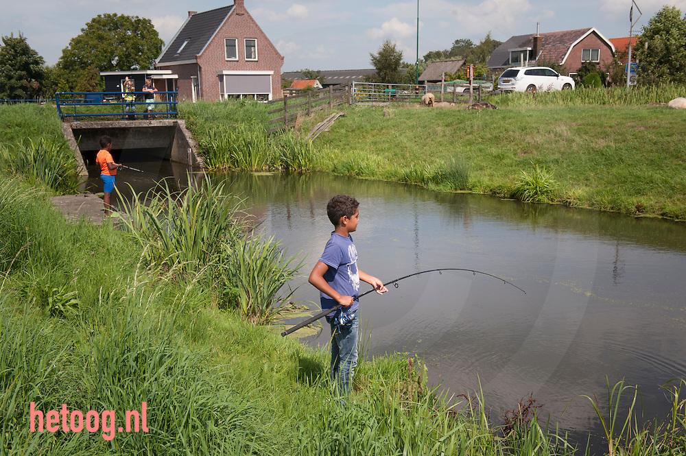 The Netherlands, Nederland 19aug2015 vissers bij het plaatsje  Polsbroek.