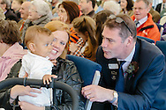 Royal Highland Show 2015, Royal Highland Centre, Ingliston, Edinburgh.<br /> Thursday 18th June, 2015.<br /> <br /> COPYRIGHT CRAIG STEPHEN 2015. PAYMENT TO CRAIG STEPHEN, 45 VICTORIA STREET, PERTH, PH2 8LY. <br /> <br /> Tel: 07905 483532.<br /> info@craig-stephen.co.uk<br /> <br /> First ever baptism at Royal Highland Show. Andrew &amp; Jo Morris from Olrig Mains, Thurso met each other at the show and today (Sunday) RHASS Chaplain Rev Andrew Campbell from Gargunnock baptised their 10 month old daughter Emily during a packed service in the presidents pavilion. The family have been showing cattle at the show since 2010 and sheep for many years prior to that.