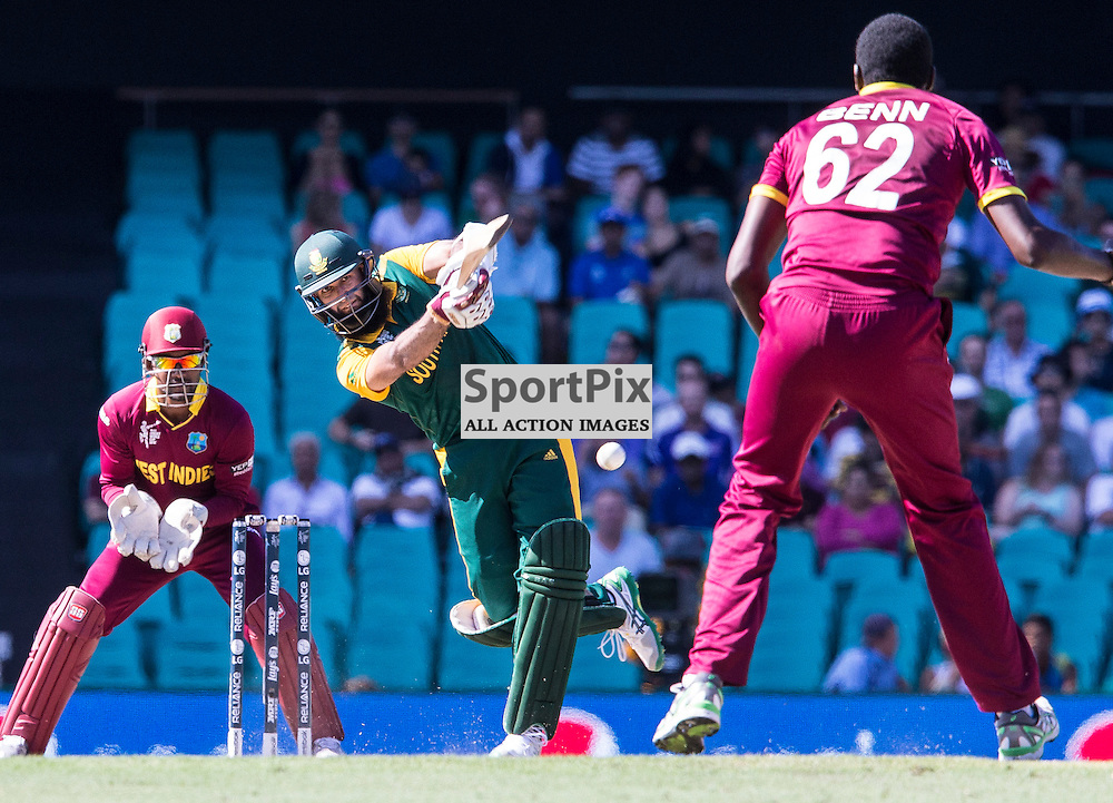ICC Cricket World Cup 2015 Tournament Match, South Africa v West Indies, Sydney Cricket Ground; 27th February 2015<br /> South Africa&rsquo;s Hashim Amla smashes a shot down the ground