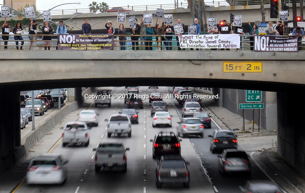 Members of Refuse Fascism protest the Tuesday firing of FBI director James Comey by President Donald Trump, on a overpass above the 101 freeway near the downtown Los Angeles federal building Wednesday, May 10, 2017.(Photo by Ringo Chiu/PHOTOFORMULA.com)<br /> <br /> Usage Notes: This content is intended for editorial use only. For other uses, additional clearances may be required.