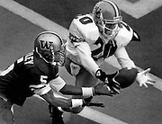 Mario Bailey (5) waits for the ball to pass through the hands of Oregon's Daryle Smith before making his 10th touchdown reception of the season. (Mark Harrison / Seattle Times, 1992)