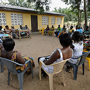 A 'Banking on Change' Village Savings and Loan Association (VSLA) meeting at Dabala Junction in the Volta Region of Ghana on 12 September 2012. Members contribute savings weekly and receive a payout commensurate with their inputs at the end of each year. Members may also access small loans, which many use to support entrepreneurial activities, and they make small insurance contributions which may be drawn upon in the event that an individual member has a financial emergency.