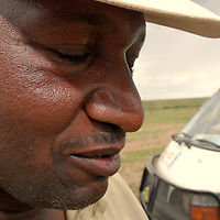 Local guide at the the Masai Mara National Park on a four wheeler vehicle