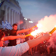 Supporters of Adonis Samaras set flares alight in support of their New Democracy leader in Athens, Greece. Image © Angelos Giotopoulos/Falcon Photo Agency