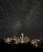 To offer a view of what the night sky over Seattle would look like without light pollution, photographer Benjamin Benschneider created a photo illustration in two steps. First, he photographed the Seattle skyline from Queen Anne Hill. Next, he obtained a wide-field photo of the south Milky Way from and by Maxine Nagel, treasurer of the Seattle Astronomical Society. He then blended the images to create this one. (Benjamin Benschneider / The Seattle Times)