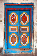 Painted wooden door. Nagore. South India.