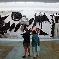 MIAMI, FL -- January 19, 2008 -- Visitors meander through the installation of art and sculpture by Thomas Zipp at The Rubell Family Collection in the Wynwood Art District in Miami, Fla., on Saturday, January 19, 2008.  The collection is expansive in a 45,000 sq. ft. former D.E.A. confiscated-goods warehouse with contemporary works collected by the Rubell family since the 1960's.