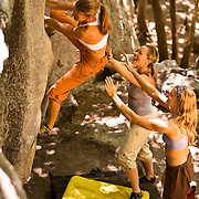 While her friends provide encouragement and spotting protection should she fall, Trindl Nebeker works one of the bouldering problems in Little Cottonwood Canyon, Utah's Wasatch Range.