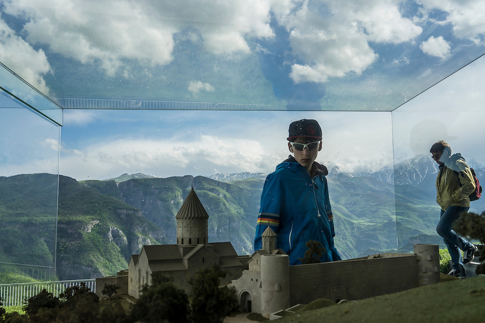 A boy looks at a model of the Tatev Monastery at the starting point of the Wings of Tatev aerial tramway on Saturday, May 7, 2016 in Halidzor, Armenia.