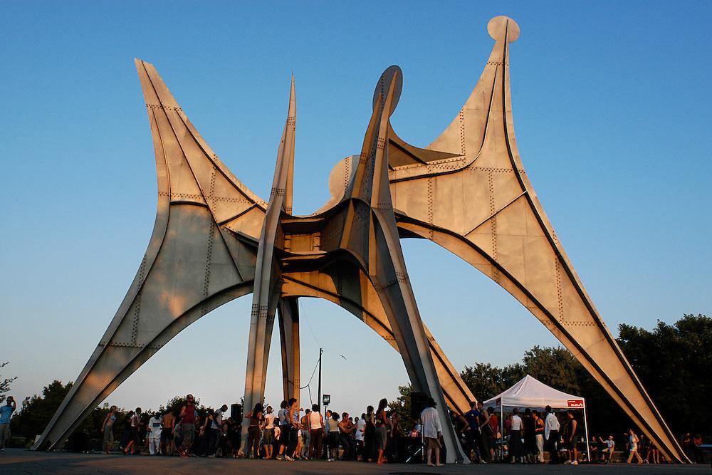Piknik electronik sunday gathering underneath Calder sculpture, Montreal