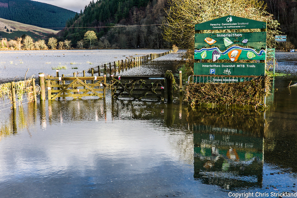 Innerleithen, Peebles, Scotland, UK. 31st December 2015. The car park of a downhill mountain bike trail near Peebles remains under water after Storm frank. The area's hills are mostly manged by the Forestry Commission and draw mountain bikers from all over the World. The steep hills are also suitable for fast flowing water filling the valley bottoms as well as fast bikes.