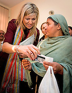 Queen Maxima of the Netherlands visits Benazir Income Support Programme (BISP) during a field visit in Rawalpindi  and islamabad on 10 february 2016 . Queen Maxima is in Pakistan as United Nations Secretary-General&rsquo;s Special Advocate for Inclusive Finance for Development to promote and support financial services in development countries. copyright robin utrecht<br /> RAWALPINDI - Koningin Maxima tijdens een bezoek aan het Benazir Income Support Program, het programma voor inkomenssteun van de Pakistaanse overheid aan getrouwde vrouwen. Maxima brengt een driedaags bezoek aan het Aziatische land als speciaal pleitbezorger van de VN op het gebied van inclusieve financiering voor ontwikkeling.