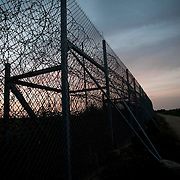 The construction of the 12.5-kilometer barbed-wire fence along the land border with Turkey, which was met with skepticism at home as well as from many EU officials, has allegedly succeeded in blocking one of the most popular transit routes for migrants seeking to make their way to the West.  Image © Angelos Giotopoulos/Falcon Photo Agency