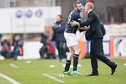 Dundee's Craig Beattie and Falkirk's manager Gary Holt.<br /> Dundee 0 v 1 Falkirk, Scottish Championship game played today at Dundee's Dens Park.<br /> &copy; Michael Schofield.