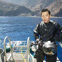 Eric Cheng, topside in Guadalupe, Mexico on a great white shark trip.