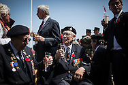 British veterans having a glass of Champagne during the official 69th anniversay celebration ceremony in Arromanches