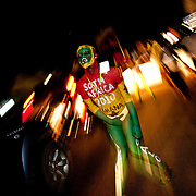 A street performer painted in the colors of the Ghanaian flag clutches a crotch full of tips on Oxford Street in Accra, Ghana as Ghanaians took to the streets to celebrate their win over the USA on 26 June 2010 during the FIFA World Cup.