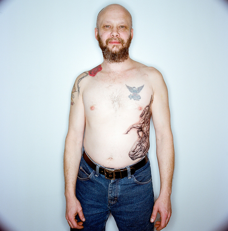 Mike Willmon showing us his tattoos in Anchorage, Alaska.